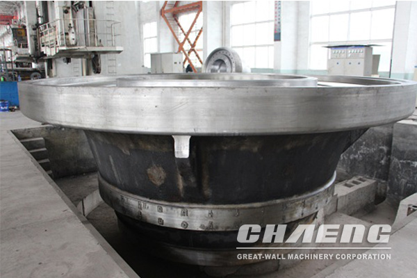 What casting process is used to process the vertical roll mill grinding table?
